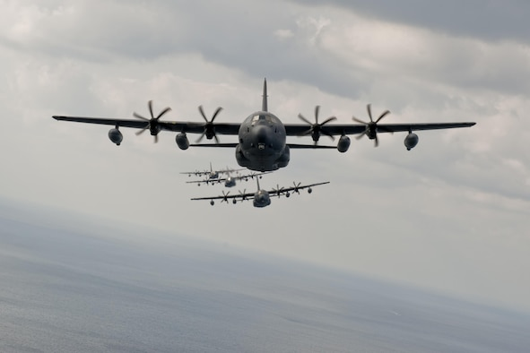 MC-130J Command IIs assigned to the 17th Special Operations Squadron fly in formation Feb. 17, 2016, off the coast of Okinawa, Japan. The 17th SOS conducted a unit-wide training exercise which tasked the entire squadron with a quick-reaction, full-force sortie involving a five-ship formation flight, cargo drops, short runway landings and takeoffs, and helicopter air-to-air refueling. (U.S. Air Force photo/Senior Airman Peter Reft)