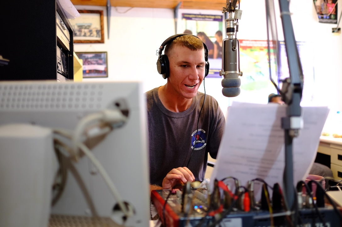 Senior Airman Lucian Root, a Civil Action Team 554-01 structural journeyman from the 36th Civil Engineer Squadron at Andersen Air Force Base, Guam, speaks into the microphone during a radio show, Feb. 18, 2016, on Palau. Airmen of CAT 554-01 provided construction capabilities, apprenticeship training, medical outreach and community engagement opportunities while deployed to Palau. Members also hosted a radio program every week informing listeners about current and completed projects and playing American music. (U.S. Air Force photo/Staff Sgt. Christopher Stoltz)