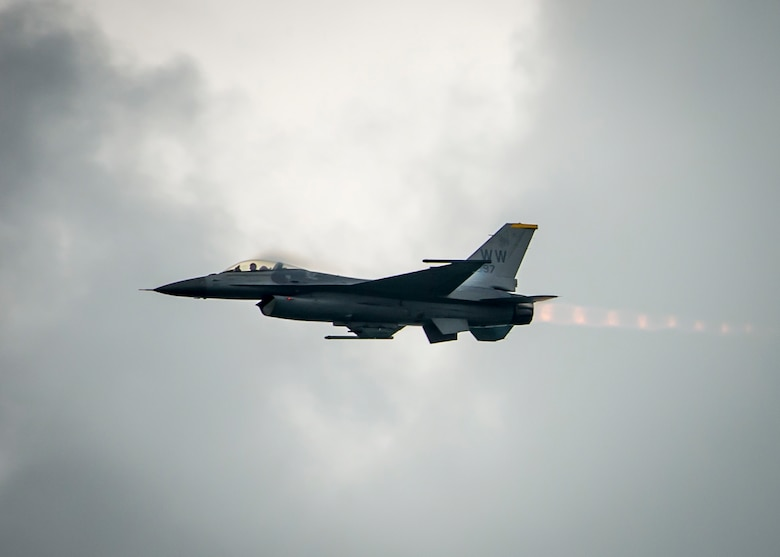 An F-16C Fighting Falcon from the 35th Fighter Wing at Misawa Air Base, Japan, performs an aerial demonstration during the Singapore International Airshow at Changi International Airport, Singapore, Feb. 20, 2016. The show was an opportunity for the U.S. to demonstrate flexible combat capabilities and to deter adversaries, while reassuring allies and partners. (U.S. Air Force photo/Capt. Raymond Geoffroy)