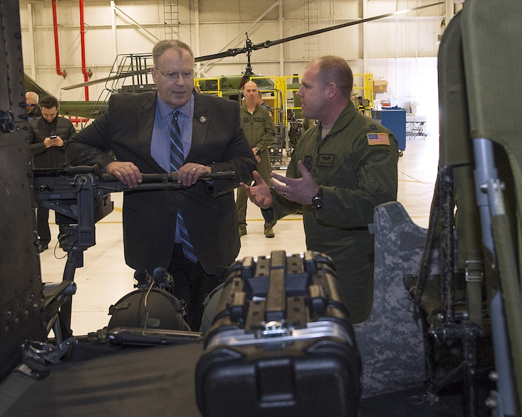 Capt, Derek Carden, 37th Helicopter Squadron pilot, briefs Deputy Secretary of Defense Bob Work, Feb. 24, 2015, on the capabilities and challenges of the UH-1N Huey helicopter as it is used by the U.S. Air Force's missile wings. Work visited the 90th MW and F.E. Warren Air Force Base, Wyo., to be briefed on the state of the nation's nuclear deterrence and to talk with the Airmen doing the job. (U.S. Air Force photo by R.J. Oriez)