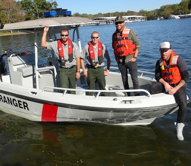 "Preston Brust (second from right) and Chris Lucas (Right) of the country music duo LoCash pose with U.S. Army Corps of Engineers Park Rangers (include names) at Old Hickory Lake in Hendersonville, Tenn, Oct. 19, 2015.  The group filmed a water safety PSA that features LoCash's hit song ""I Love This Life,"" which is currently moving up the country music charts. It is being used to support the USACE National Water Safety Campaign ""Life Jackets Worn, Nobody Mourns."""
