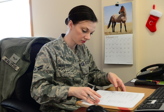 U.S. Air Force Airman 1st Class Chelsea Walters, a 354th Force Support Squadron customer service apprentice, reviews a personnel file, Feb. 25, 2016, at Eielson Air Force Base, Alaska.  Walters works for the Military Personnel Section documenting awards, decorations and in-processing paperwork among other items for Airmen. (U.S. Air Force photo by Airman 1st Class Cassandra Whitman/Released)