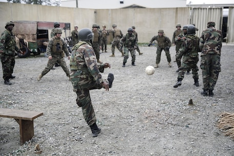 Marines with Combat Logistics Battalion 2 from a Theater Security Cooperation team play a game of soccer with African military role players at the Infantry Immersion Trainer on Camp Lejeune, N.C., Feb. 23, 2016. Marines with the battalion practiced the type of training they would provide to a partner African military force in preparation for Special Purpose Marine Air-Ground Task Force-Crisis Response-Africa. (U.S. Marine Corps photo taken by Cpl. Alexander Mitchell/released)