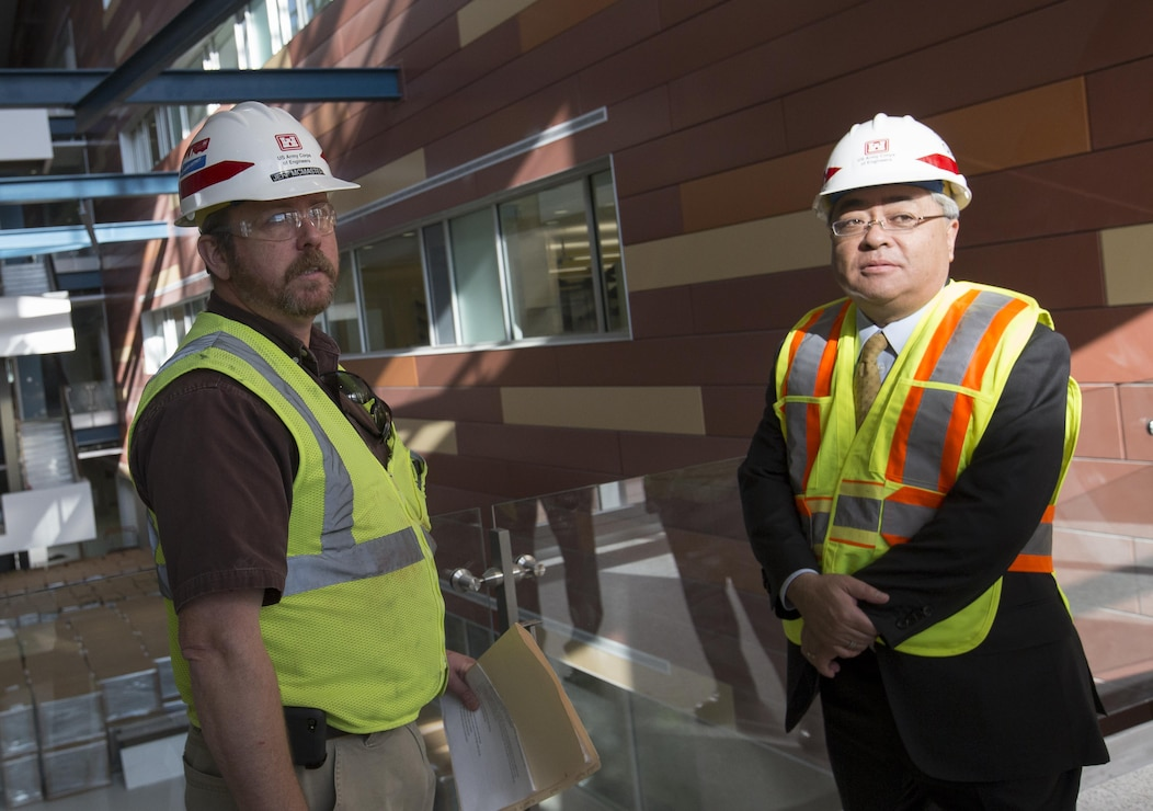 Resident Engineer Jeff McMaster briefs Kazuhiro Watanabe, Japanese Ministry of Defense director general for facilities and installation, on the construction progress at the U.S. Army Medical Research Institute for Infectious Diseases at Fort Detrick on Nov. 18. The two-hour tour moved throughout the huge facility with McMaster highlighting design, materials and construction processes. The seven-person MOD delegation is visiting several Army and Navy military construction projects.
