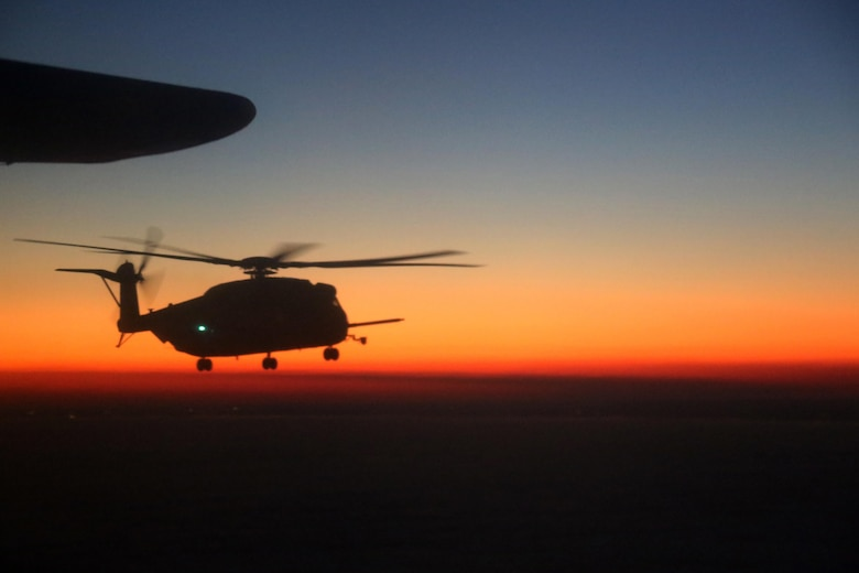 A CH-53E Super Stalion flies through the evening sky during an aerial refueling mission over the Atlantic Ocean Feb. 11, 2016. Marine Aerial Refueler Transport Squadron 252 conducted aerial refueling missions off the North Carolina coast to provide routine training for both pilots and crew members. Aerial refueling enables aircraft with short ranges of flight to significantly extend their operational reach. This capability enables missions to be executed more efficiently, which gives the pilots the ability to provide quicker and more extensive support to the Marines on the ground. (U.S. Marine Corps photo by Cpl. N.W. Huertas/Released)