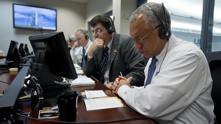 NASA Administrator Charles Bolden, right, monitors the countdown of the United Launch Alliance Atlas V rocket carrying the Mars Science Laboratory Curiosity along with NASA Associate Administrator Chris Scolese, Saturday, Nov. 26, 2011, at the ULA launch control center on Cape Canaveral Air Force Station, Fla.  NASA began a historic voyage to Mars with the launch of the car-sized rover which lifted off at 10:02 a.m. EST. The mission will pioneer precision landing technology and a sky-crane touchdown to place Curiosity near the foot of a mountain inside Gale Crater on Aug. 6, 2012.