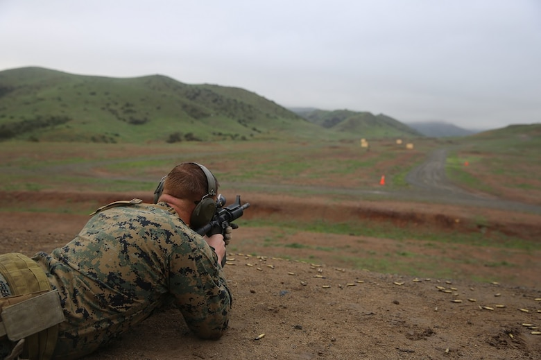Sgt. Thomas Sereika shoots at the Autonomous Robotic Human Type Target Feb. 18, at Camp Pendleton. By testing these new moving targets from different ranges with a variety of weapons systems, the Marines assess how the targets could improve their training. Sereika is the lead instructor with the Formal Marksmanship Training Center at Division Schools, 1st Marine Division, and is a native of Simi Valley. (U.S. Marine Corps Photo by Cpl. John Baker)