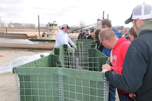 As part of the U.S. Army Corps of Engineers, Omaha District's annual flood fight training program, attendees, learned flood fight measures such as placing and filling HESCO bastions.