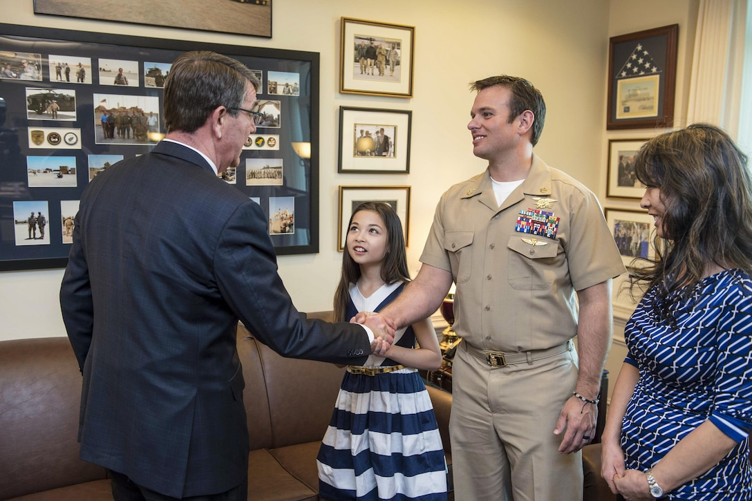 Defense Secretary Ash Carter meets with Navy Senior Chief Petty Officer Edward C. Byers Jr., selected to receive the Medal of Honor, and his family at the Pentagon, Feb. 26, 2016. President Barack Obama is scheduled to present the medal to Byers during a ceremony at the White House Monday. DoD photo by Navy Petty Officer 1st Class Tim D. Godbee