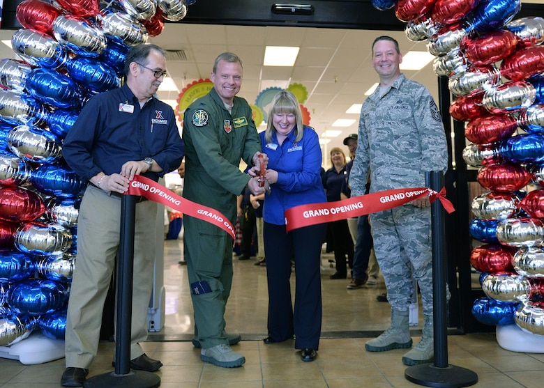 Beale leadership and Exchange management cut the ribbon during the grand re-opening of the newly renovated Base Exchange Feb. 25, 2016, Beale Air Force Base, California. The remodeling project cost approximate$1.9 million, which includes new flooring, a floor plan to accommodate an expanded product line, new displays, and a new central checkout location. (U.S. Air Force photo by Robert Scott)