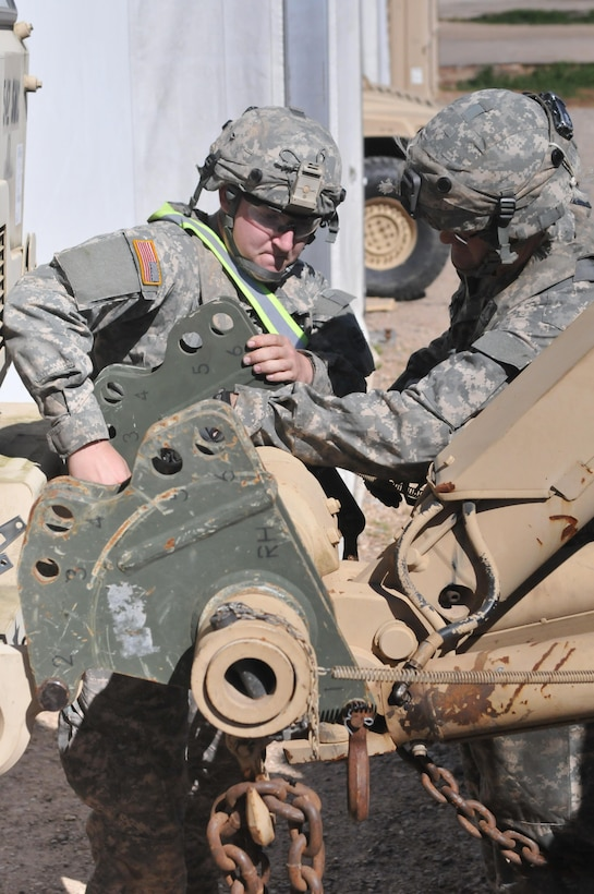 Spc. Elijah Andrews, a wheeled vehicle mechanic with the 103rd Quartermaster Company and a Bellingham, Wash., native, readies a vehicle for towing Feb. 18 at Fort Polk, La. Mechanics of the 103rd Quartermaster Company, an Army Reserve unit from Houston and many other units from around the U.S. have been working together during the Joint Readiness Training Center's rotation 16-04 operation. The units have come together during the exercise to provide maintenance support for the 4th Brigade Combat Team (Airborne). (U.S. Army Photo by Sgt. Aaron Ellerman 204th Public Affairs Detachment/Released)