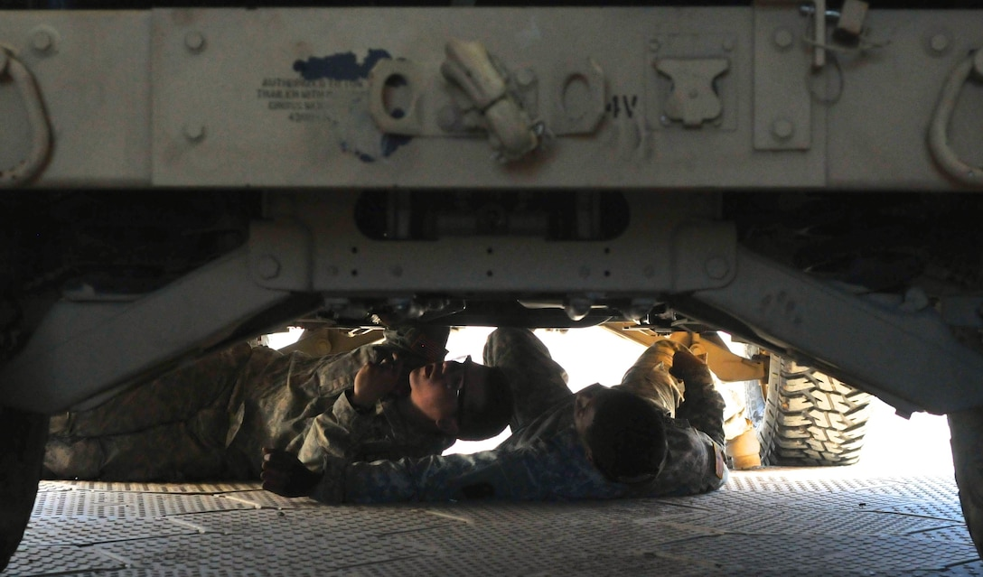 Army mechanics work on the underbelly of a Humvee in the maintenance tent of the 542nd Sustainment Maintenance Company Feb. 18 at Fort Polk, La. The maintenance bay has been home to mechanics from several different units and components during the Joint Readiness Training Center's rotation 16-04 operation. The Soldiers have come together during the exercise to provide maintenance support for the 4th Brigade Combat Team (Airborne). (U.S. Army Photo by Sgt. Aaron Ellerman 204th Public Affairs Detachment/Released)