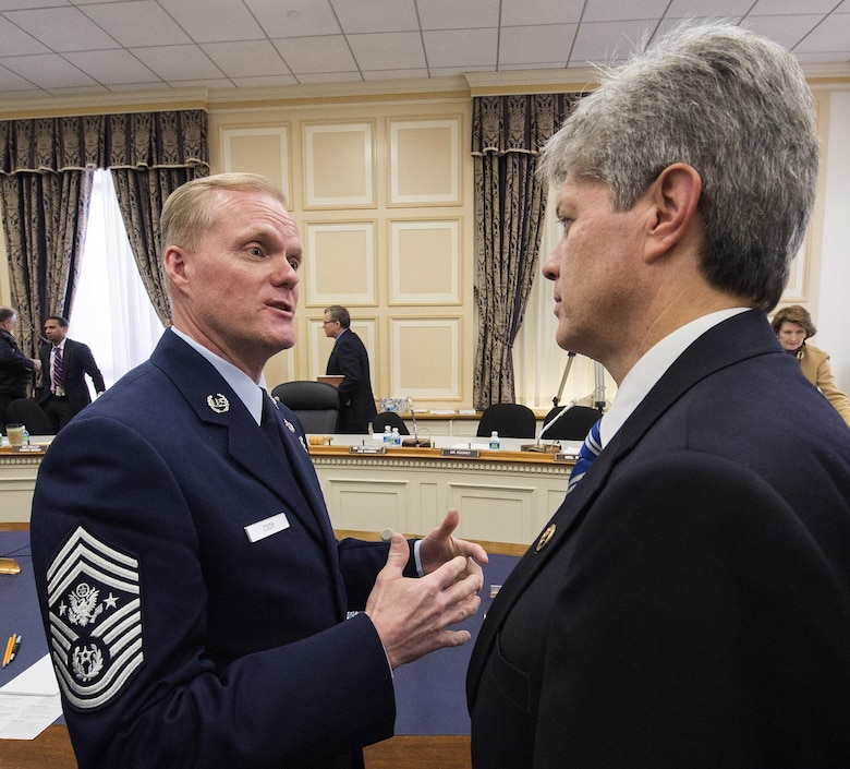 Chief Master Sgt. of the Air Force James A. Cody talks with Rep. Jeff Fortenberry (R-Neb.) following a hearing of the House Appropriations Committee's Subcommittee on Military Construction and Veterans Affairs Feb. 26, 2016, in Washington, D.C. Fortenberry is vice chair of the subcommittee. The oversight hearing was being held to learn about quality of life in the military concerns from each of the service's senior most enlisted members. During his opening statement Cody stressed the cumulative impacts of sequestered and reduced budgets on the compensation and quality of life of Airmen and their families. Cody stressed that the Airmen who serve today do so freely, proudly and voluntarily because they believe in what America stands for and are ready to defend its cause. He added that our nation must honor that commitment by providing for them and their families. (U.S. Air Force photo/Jim Varhegyi)