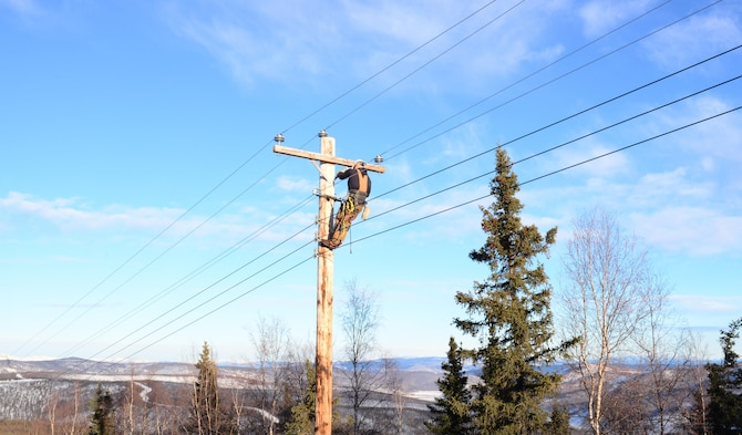 U.S. Air Force Senior Airman Travis Bothast, a 354th Civil Engineer Squadron electrical systems journeyman, works on a utility pole Feb. 5, 2016, at Eielson Air Force Base, Alaska. Bothast works on the exterior side of electrical systems, maintaining streetlights, utility poles and the Yukon Training Range. (U.S. Air Force photo by Airman 1st Class Cassandra Whitman/Released)
