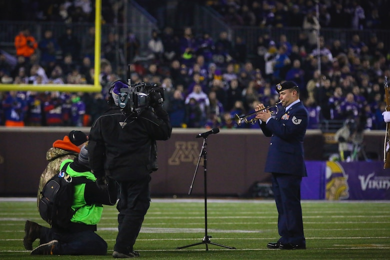 Tech. Sgt. Johnny Holliday plays the National Anthem at the Minnesota Vikings vs. New York Giants NFL playoff game Dec. 27. (Courtesy Photo by Nathan Wallin)