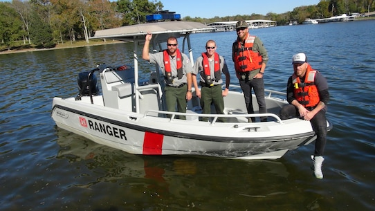 """Preston Brust (second from right) and Chris Lucas (Right) of the country music duo LoCash pose with U.S. Army Corps of Engineers Park Rangers Jacob Albers (Left) and Brent Sewell at Old Hickory Lake in Hendersonville, Tenn, Oct. 19, 2015.  The group filmed a water safety PSA that features LoCash's hit song """"I Love This Life,"""" which is currently moving up the country music charts. It is being used to support the USACE National Water Safety Campaign """"Life Jackets Worn, Nobody Mourns."""""""