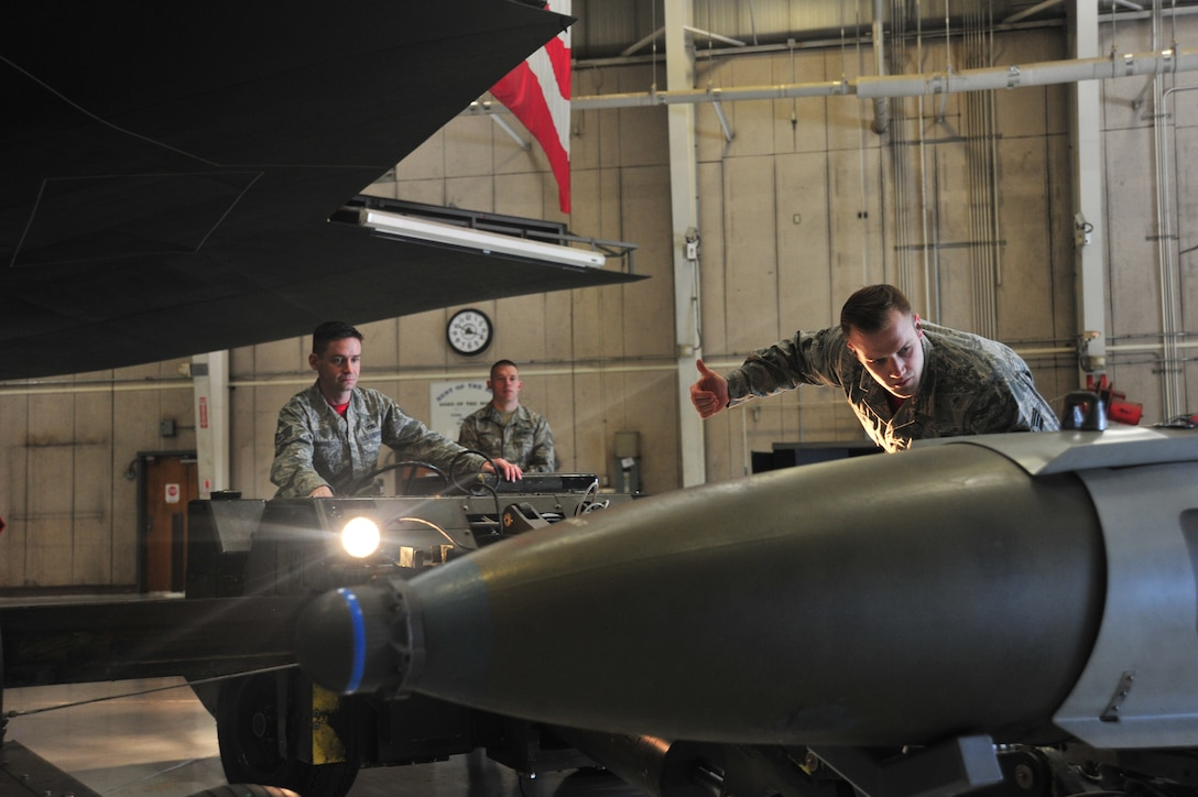 U.S. Air Force Senior Airman John Anderson, right, directs Staff Sgt. Jake Smith, both load crew members of the 131st Aircraft Maintenance Unit, as a trainer weapon is loaded onto a jammer during the annual Weapons Load Competition at Whiteman Air Force Base, Mo., Feb. 19, 2016. Load crew competitions help Airmen maintain their mission-readiness, ensuring they can perform at any given time.