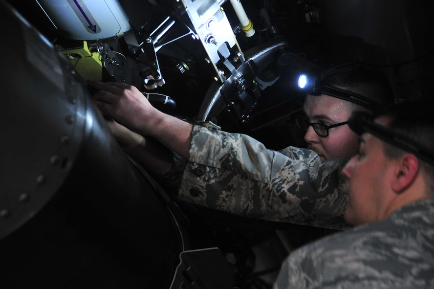 U.S. Air Force Tech. Sgt. Daniel Jensen, a load crew member assigned to the 131st Aircraft Maintenance Unit, secures the final trainer weapon for his team during the Annual Weapons Load Competition at Whiteman Air Force Base, Mo., Feb. 19, 2016. Each team must load two trainer weapons in addition to restocking all equipment before time is called.