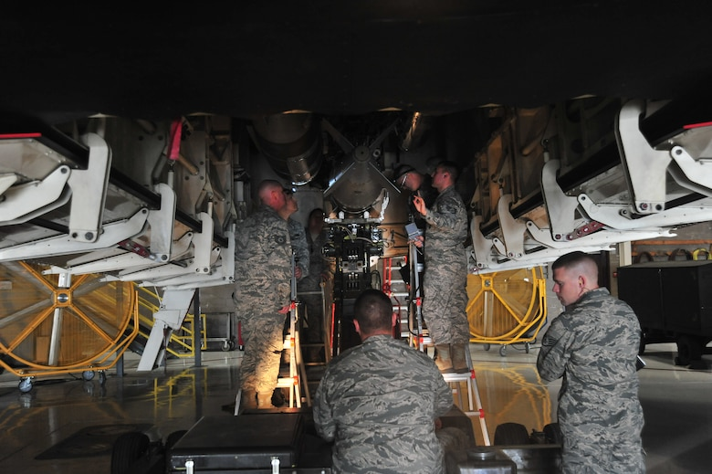 Load crew members of the 131st Aircraft Maintenance Unit load training munitions during the Annual Weapons Load Competition at Whiteman Air Force Base, Mo., Feb. 19, 2016. The load crews participating in the annual competition are crews who previously won a quarterly competition.