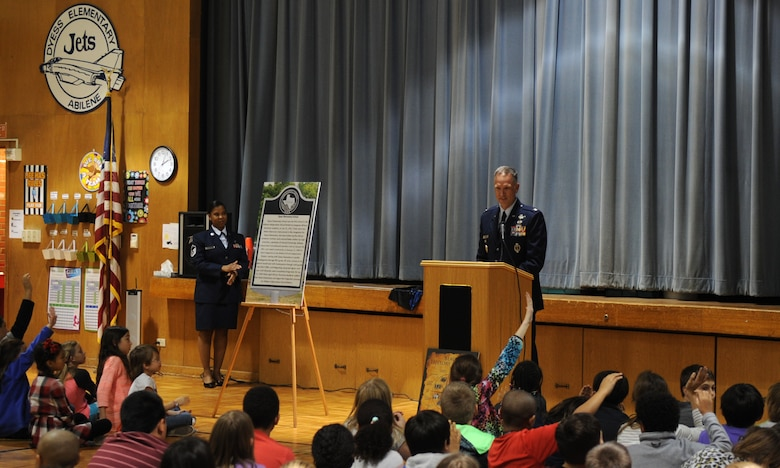 U.S. Air Force Col. Michael Miller, 7th Bomb Wing vice commander, speaks to students at Dyess Elementary Feb. 22, 2016, in Abilene, Texas. During a ceremony at Dyess Elementary, honoring it for being the first racially integrated school in Abilene, Miller communicated to students the importance of having a historical marker dedicated to their school and encouraged them to continue to be active in their community because they all have the potential to make a significant impact.  (U.S. Air Force photo by Senior Airman Shannon Hall/Released)