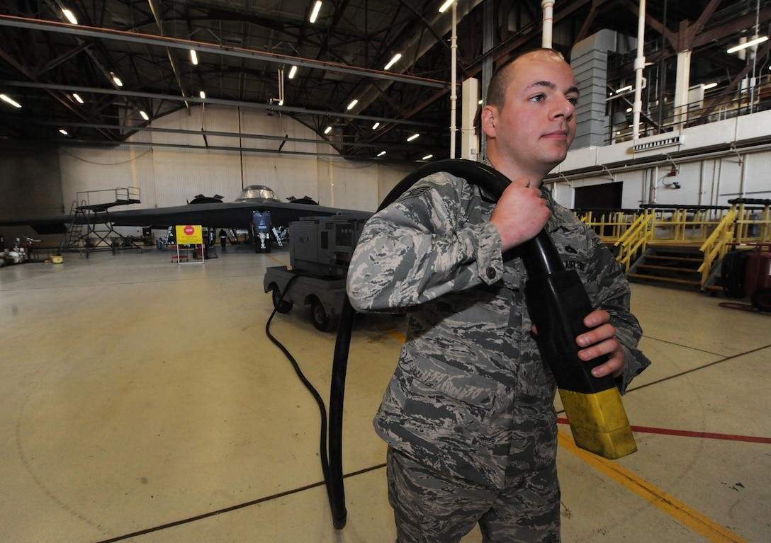 U.S. Air Force Tech Sgt. Aaron Bradley, a 393d Aircraft Maintenance Unit specialist section chief, prepares to supply power to a B-2 Spirit at Whiteman Air Force Base, Mo., Feb. 18, 2016. The power, provided by a generator, allows operation of the aircraft avionics system and is essential when working on the B-2's landing gear. (U.S. Air Force photo by Tech. Sgt. Miguel Lara III)