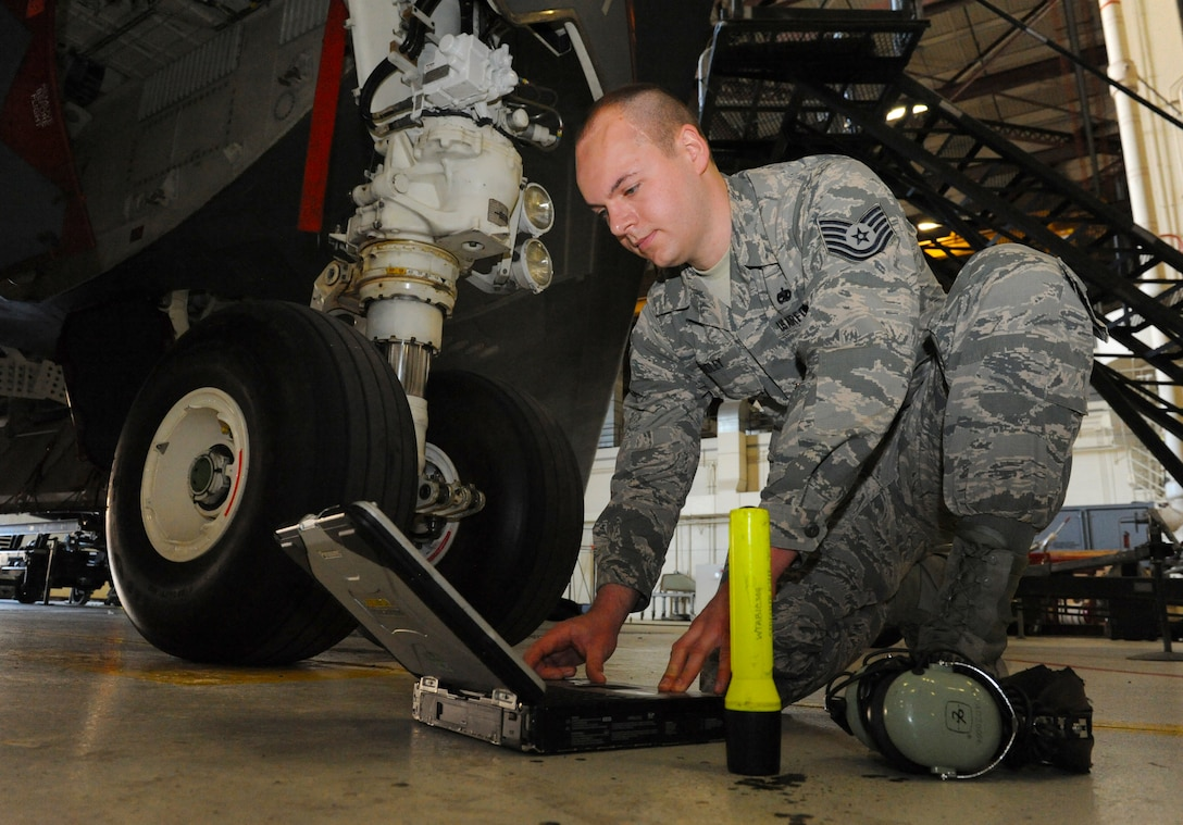U.S. Air Force Tech Sgt. Aaron Bradley, a 393d Aircraft Maintenance Unit specialist section chief, reviews technical orders prior to maintenance work on a B-2 Spirit at Whiteman Air Force Base, Mo., Feb. 18, 2016. As the specialist section chief, Bradley has oversight of over 80 personnel of the aircraft hydraulics section, propulsion section and electrical and environmental section. Bradley is also responsible for the maintenance of the 4,000 psi hydraulic system which operates the B-2 flight controls, landing gear, brakes, steering and weapon systems.  The maintenance performed by the hydraulics section ensures the B-2 is mission ready. (U.S. Air Force photo by Tech. Sgt. Miguel Lara III)