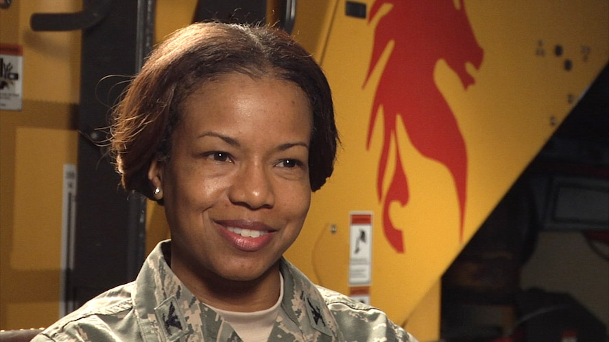 Col. Yvonne Spencer, 819th RED HORSE Squadron commander, sits in an interview Feb. 25, 2016, at Malmstrom Air Force Base, Mont. Spencer is the first African American and first female to lead the 819th RHS. (U.S. Air Force photo/Beau Wade)