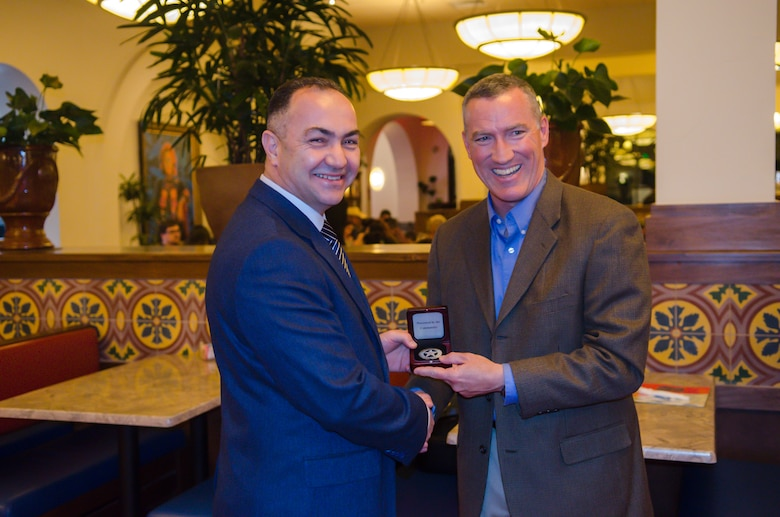 "U.S. Air Force Maj. Gen. Ed Wilson (right), 24th Air Force and Air Forces Cyber Command (AFCYBER) commander presents Turkish Air Force Brig. Gen. Atilla Yurttas, Head of Communication and Information Branch and member of a cybersecurity delegation with a 24AF ""ranger badge"" as a gift during an official dinner following their visit to Headquarters, 24AF - AFCYBER, Joint Base San Antonio - Lackland, Texas, Feb 23. The delegation visit was centered upon strengthening U.S. and allied forces partnerships as well as to gain further insight on how 24AF - AFCYBER organizes, trains, equips, and tasks our cyber forces. (Courtesy Photo/Released)"