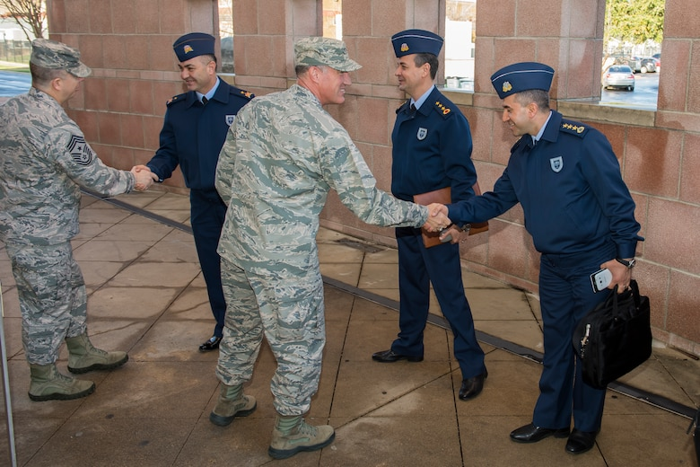 U.S. Air Force Maj. Gen. Ed Wilson (center), 24th Air Force and Air Forces Cyber Command (AFCYBER) commander and Chief Master Sgt. Brendan Criswell (left), 24AF/AFCYBER Command Chief shake hands with Turkish Air Force members of a cybersecurity delegation during their visit to Headquarters, 24AF - AFCYBER, Joint Base San Antonio - Lackland, Texas, Feb 23. The delegation visit was centered upon strengthening U.S. and allied forces partnerships as well as to gain further insight on how 24AF - AFCYBER organizes, trains, equips, and tasks our cyber forces. (U.S. Air Force photo by Master Sgt. Luke P. Thelen/Released)