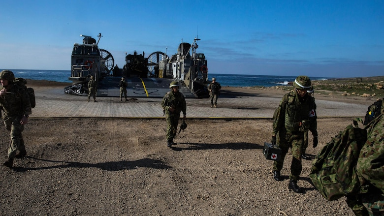 Soldiers with Western Army Infantry Regiment, Japan Ground Self-Defense Force, disembark a Landing Craft Air Cushion onto San Clemente Island, Feb. 21, 2016, in preparation for the supporting arms coordination center exercise(SACCEX) portion of Exercise Iron Fist 2016. Iron Fist is an annual, bilateral amphibious training exercise designed to improve USMC and JGSDF's ability to plan, communicate and conduct combined amphibious operations at the platoon, company and battalion levels.