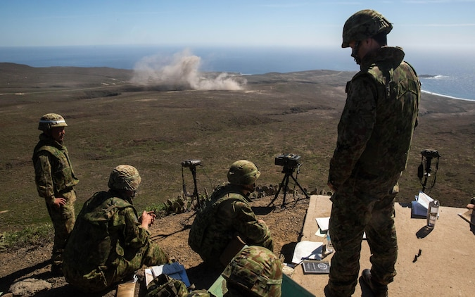 Soldiers with Western Army Infantry Regiment, Japan Ground Self-Defense Force, observe naval gunfire from the USS Spruance (DDG-111) during a supporting arms coordination center exercise (SACCEX) at San Clemente Island, Feb. 22, 2016, as part of Exercise Iron Fist 2016. SACCEX  serves as a cooperative learning tool for the US-Japan partnership through the operation of supporting arms coordination center, which has developed the USMC and JGSDF's ability to intergrate naval gunfire, mortars and close-air support  as a combined force.