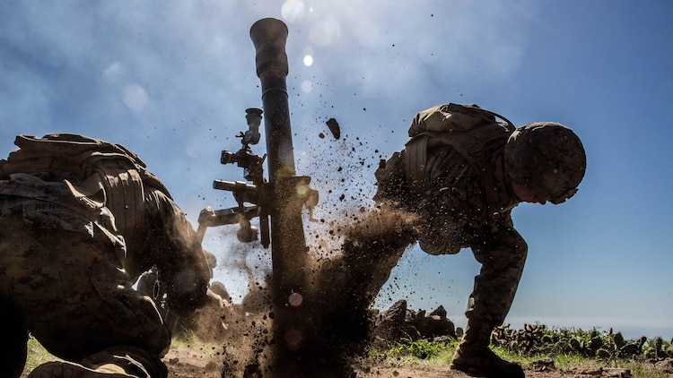 Pfc. Bradley Brandes, a mortarmen with Weapons Company, 1st Battalion, 4th Marine Regiment, fires an 81mm mortar system during the supporting arms coordination exercise (SACCEX) portion of Exercise Iron Fist 2016 on San Clemente Island, Feb. 21, 2016. Iron Fist is an annual, bilateral amphibious training exercise designed to improve U.S. Marine Corps and Japan Ground Self-Defense Force's ability to plan, communicate and conduct combined amphibious operations at the platoon, company and battalion levels.