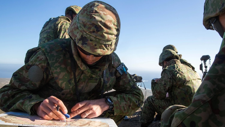 A soldier with Western Army Infantry Regiment, Japan Ground Self-Defense Force, plots map points for impending naval gunfire during a supporting arms coordination center exercise(SACCEX) at San Clemente Island, Feb. 21, 2016, during Exercise Iron Fist 2016. The SACCEX serves as a cooperative learning tool for the US-Japan partnership through the operation of a supporting arms coordination center, which has developed the USMC and JGSDF's ability to integrate naval gunfire, mortars and close-air support  as a combined force.