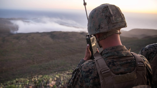 Lance Cpl. Christian Frohlich, a radio operator with 1st Air Naval Gunfire Liasion Company, relays fire missions to the objective area of a naval gunfire bombing range during the supporting arms coordination center exercise (SACCEX) portion of Exercise Iron Fist 2016, on San Clemente, Feb. 21, 2016. The SACCEX provides U.S. and Japanese forces with hands-on experience in tactics proven to be effective in securing enemy-occupied shorelines during large-scale amphibious assaults.