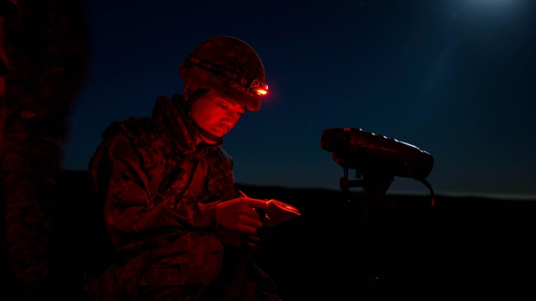 A soldier with Western Army Infantry Regiment, Japan Ground Self-Defense Force, reviews fire mission calls during a supporting arms coordination center (SACCEX) exercise at San Clemente Island, Feb. 21, 2016, as part of Exercise Iron Fist 2016. The SACCEX serves as a cooperative learning tool for the US-Japan partnership through the operation of a supporting arms coordination center, which has developed the USMC and JGSDF's ability to integrate naval gunfire, mortars and close-air support  as a combined force.