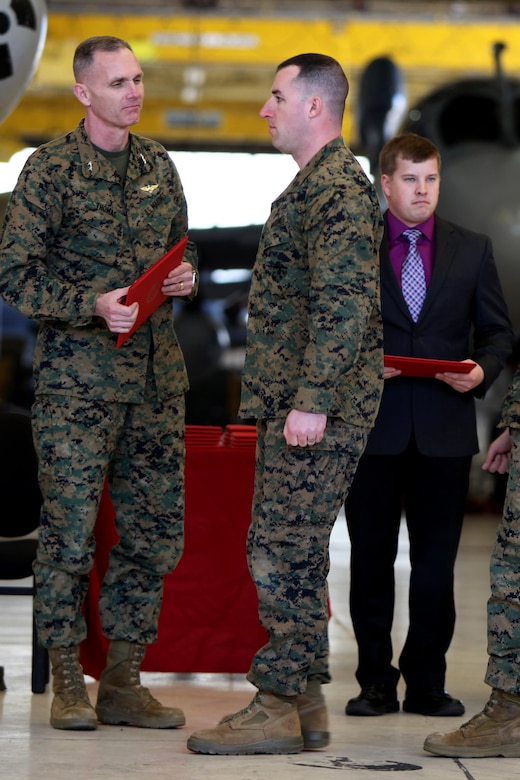 Sergeant Eric Foldvary prepares to receive a certificate from Maj. Gen. Gary L. Thomas after completing the Squadron Intelligence Training and Certification Course at Mid Atlantic Electronic Warfare Range, N.C., Feb. 12, 2016. To date, the course has certified more than 300 Marines enabling them to better integrate into the Marine Air-Ground Task Force. Thomas is the commanding general of 2nd MAW, Foldvary is an intelligence specialist with Marine Aircraft Group 14. (U.S. Marine Corps photo by Cpl. Jason Jimenez/Released)