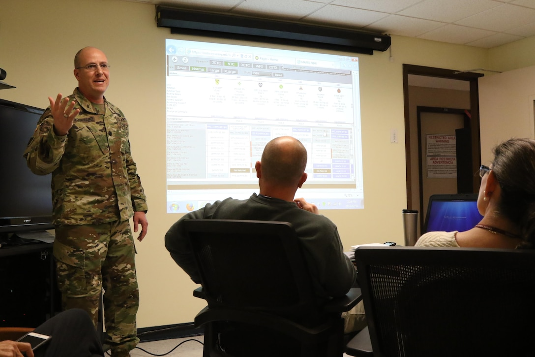 Lt. Col. Bentio demonstrates the Mission Analysis, Readiness & Resource Synchronization (MARRS) system during a brief to various Army Reserve Soldiers in leadership roles. The MARRS system provides information and has the capacity to leverage Reserve Component Manpower System and other Reserve Component unique data to better facilitate the capabilities of the Army Reserve. (U.S. Army Reserve photo by Sgt. Bethany L. Huff)