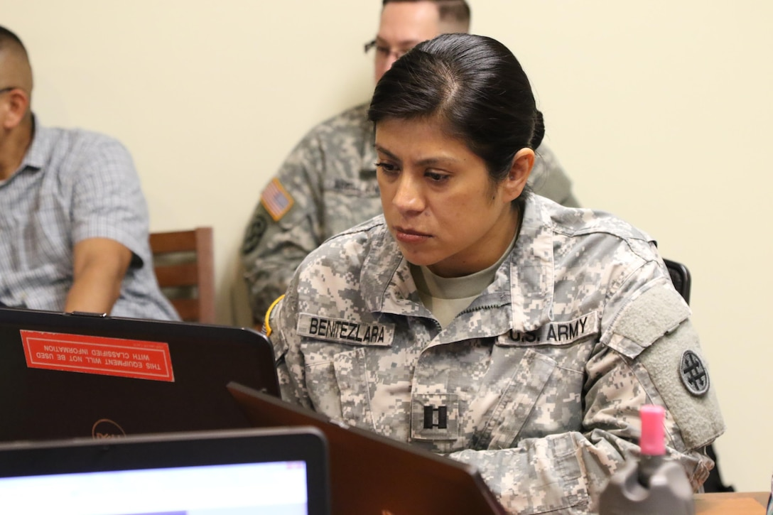 Capt. Gabrila Benitezlara, the Collective Training Officer in Charge for the 4th Expeditionary Sustainment Command, tests out the new Mission Analysis, Readiness & Resource Synchronization (MARRS) system during an information brief for Army Reserve Soldiers in leadership roles. The MARRS system will help to de-conflict scheduling of units as well as leveraging the remainder of Soldiers within those Reserve units. (U.S. Army Reserve photo by Sgt. Bethany L. Huff)
