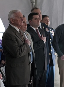 U.S. Army Reserve Ambassador Fred Fair (left), and others, put their hands on their hearts while the national anthem is being played during a memorial service in Greensburg, Pa., Feb. 25, 2016.  The memorial was for the 25th anniversary of the scud missile attack on the 14th Quartermaster Detachment during Operation Desert Storm. (U.S. Army photo by Staff Sgt. Dalton Smith/Released)