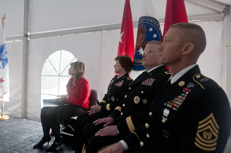 The official party of the 25th memorial service for the 14th Quartermaster Detachment, from the left, Councilwoman Kathleen McCormick, from the city of Greensburg, Pa., Maj. Gen. Margaret W. Boor, commanding general of the 99th Regional Support Command, Brig. Gen. Richard C. Staats, commanding general of the 316th Sustainment Command (Expeditionary), and Command Sgt. Maj. Johnny McPeek, command sergeant major of the 316th, observe the service in Greensburg, Pa. Feb. 25, 2016. (U.S. Army photo by Staff Sgt. Dalton Smith/Released)