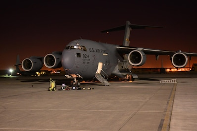 A C-17 Globemaster III from Joint Base Charleston, South Carolina undergoes maintenance in the evening at Al Udeid Air Base, Qatar Feb. 19. The C-17 fleet at AUAB is maintained by the 8th Expeditionary Air Mobility Squadron maintenance team. The team performs maintenance actions on C-17 aircraft to ensure they're mission ready. (U.S. Air Force photo by Tech. Sgt. James Hodgman/Released)