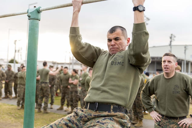 Gunnery Sgt. David Rubio, aviation ordnance chief with Headquarters and Headquarters Squadron, participates in a pull up event during the Frozen Chosin Competition at Marine Corps Air Station Iwakuni, Japan, Feb. 25, 2016. Teams consisting of six members completed a series of events including a pull up and sit up contest, a 5k supply run, a 600 meter swim, 250 meter sprint then constructing and presenting professional military education. The competition is set to resemble the rigorous struggles Marines faced during the battle of the Chosin Reservoir in 1950.