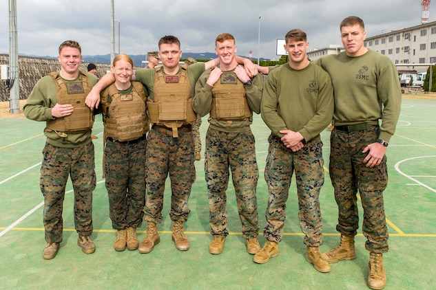 Marines with the provost marshal's office K-9 unit pose for a picture after winning the Frozen Chosin Competition at Marine Corps Air Station Iwakuni, Japan, Feb. 25, 2016. Teams consisting of six members completed a series of events including a pull up and sit up contest, a 5k supply run, a 600 meter swim, 250 meter sprint then constructing and presenting professional military education. The winner of the event will either take a trip to Iwo Jima or the demilitarized zone, a strip of land running across the Korean Peninsula that serves as a buffer zone between North and South Korea. Crossing the 38th parallel, the DMZ cuts Korea in half and is the most heavily armed border in the world.