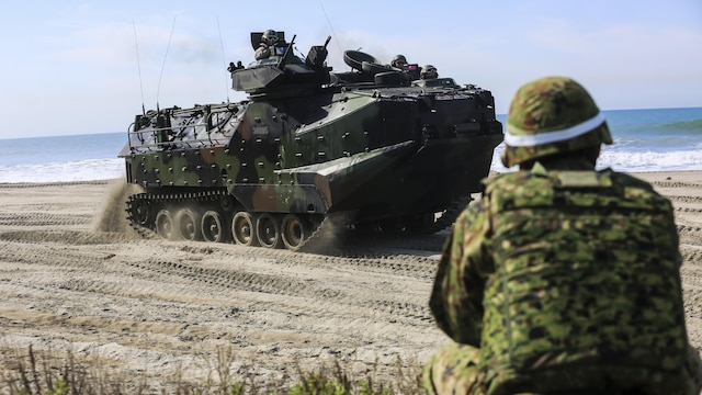 A Japan Ground Self-Defense Force solider provides security as an amphibious assault vehicle moves to a viable position to provide perimeter security during a scenario based, battalion-sized amphibious landing exercise for Exercise Iron Fist 2016, Feb. 26, 2016. Capable maritime forces help ensure stability and prosperity around the world, and bilateral exercises, like Iron Fist, help partner nations improve their own maritime capability.