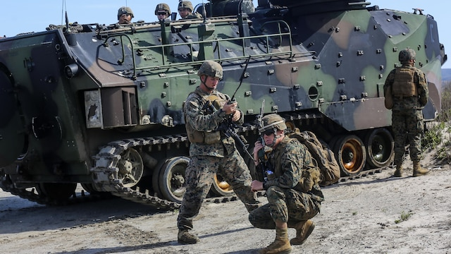 Marines with 1st Battalion, 4th Marine Regiment and 3d Assault Amphibian Battalion,1st Marine Division, I Marine Expeditionary Force, check their communication connections during a scenario-based, battalion-sized amphibious landing exercise for Exercise Iron Fist 2016, Feb. 26, 2016. Iron Fist is an annual, bilateral amphibious training exercise designed to improve USMC and JGSDF's ability to plan, communicate and conduct combined amphibious operations at the platoon, company and battalion levels.
