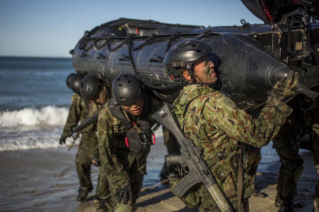 Japanese soldiers with the Japan Ground Self-Defense Force move the F470 Combat Rubber Raiding Craft off the beach during a beach raid as part of training for Exercise Iron Fist 2016, at Marine Corps Base Camp Pendleton, California, Feb. 24, 2016. Iron Fist is a five-week-long exercise focusing on advanced marksmanship, amphibious reconnaissance, fire and maneuver assaults, staff planning, logistical support and medical knowledge sharing, fire support operations, including mortars, artillery and close air support, and amphibious landing operations.