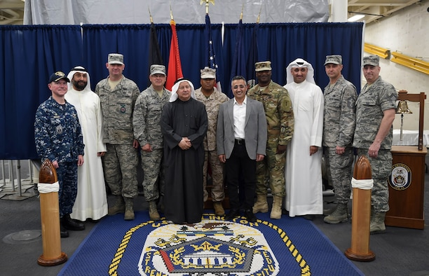 U.S. and Kuwaiti Gulf War veterans pose for a photo aboard the USS Arlington (LPD 24)during a ceremony celebrating the 25th Anniversary of the Liberation of Kuwait in Kuwait, Feb. 23, 2016. The veterans were invited to the ceremony during which they were presented a book commemorating U.S. and Kuwaiti service members' efforts leading to the country's liberation. (U.S. Air Force photo by Staff Sgt. Jerilyn Quintanilla)