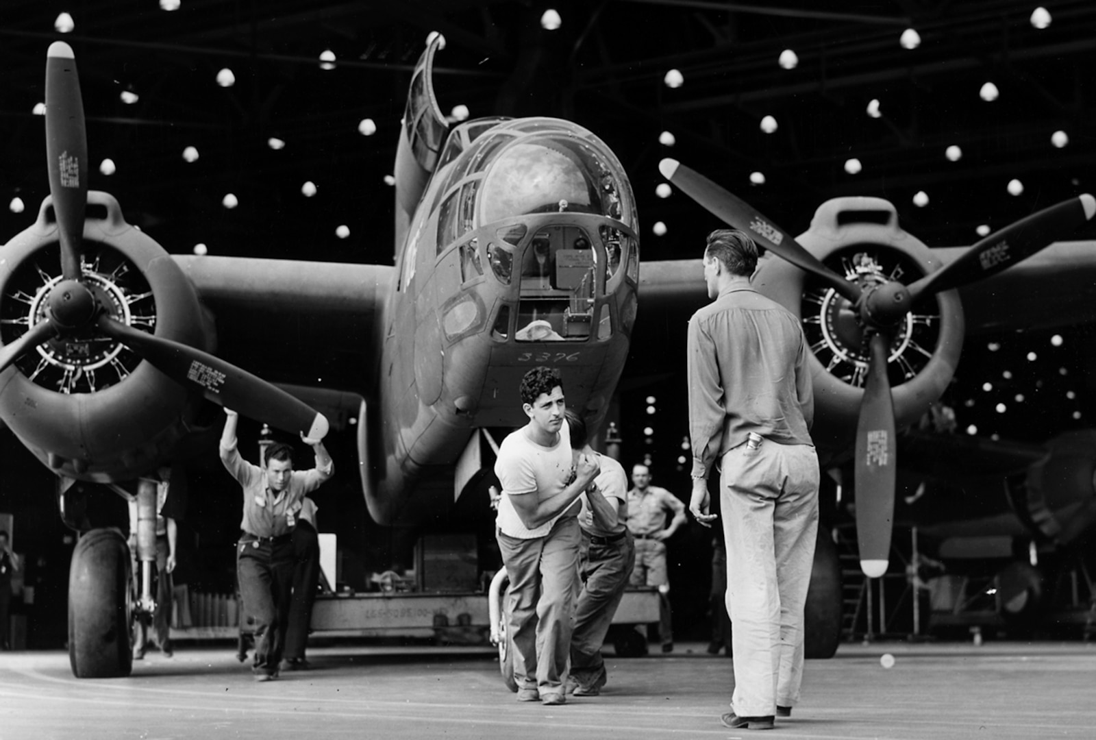 A Douglas A-20 attack bomber leaves the assembly line at the Long Beach, Calif., plant for transfer to the flight line and a test flight before delivery to the Army.