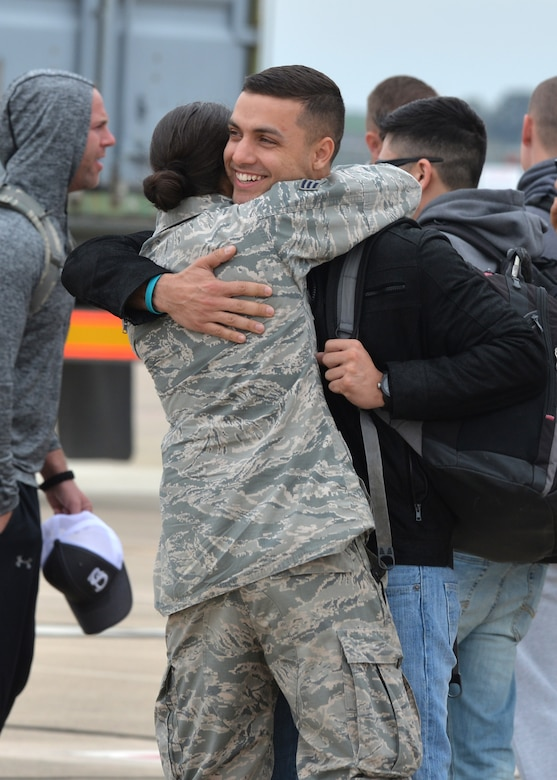 Main-body personnel from Barksdale Air Force Base, La., receive a warm welcome from advance-party Airmen upon their arrival at Morón Air Base, Spain, Feb. 26, 2016. These Airmen will be assigned to the 2nd Expeditionary Bomb Group for the duration of Cold Response 16, a large-scale NATO military training exercise. Approximately 16,000 troops from a dozen allied nations are scheduled to participate in the biennial exercise.