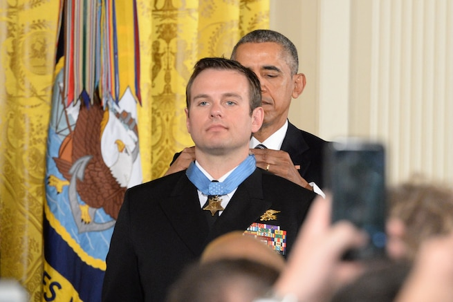 President Barack Obama presents the Medal of Honor to Navy Senior Chief Petty Officer Edward C. Byers Jr. during a White House ceremony, Feb. 29, 2016. Byers received the medal for actions while serving as part of a team that rescued an American civilian held hostage in Afghanistan in 2012. DoD photo by EJ Hersom